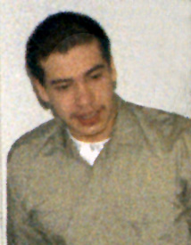 photo of Louis H. Reyes wearing green shirt