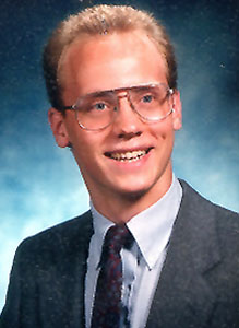 "head photo of Earl ""Eric"" Dunckel; wearing suit jacket and glasses"