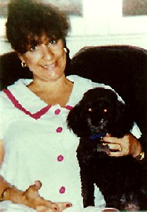 home photo of Sandra A. Sollie with dog in lap